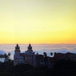 Sun setting behind Hearst Castle